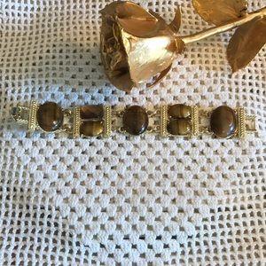 Monet lovely gold, tiger eye bracelet with Amber.
